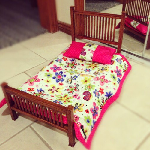 Addie's finished doll bed is nicer than your real bed. (Made by my Papa.)