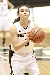 Kelsey Minato, West Point number 5, shooting a foul shot.