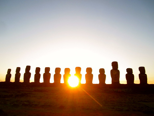 sunrise over moai in easter island