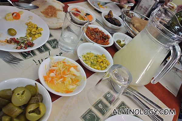Assorted pickles, humus, pita bread and a pitcher of juice was served first