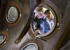 Sir Richard Branson and daughter, Holly, look through the window of a SpaceShipTwo shell being used to develop comfortable, sexy and safe cabins for our spaceships. Soon, they'll view the Earth from space through windows like these