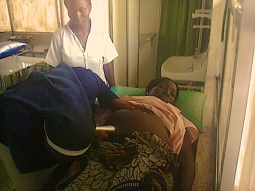 Cecilia Olusanya SSL conducting a check up on a pregnant woman in the Maternity Department of St Louis Hospital Zonkwa, Kaduna State, Nigeria
