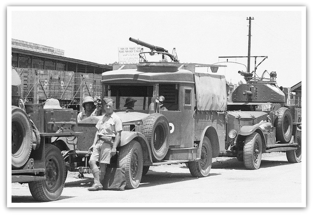 British soldiers, a  Rolls Royce Silver Ghost and armoured cars at Lydda Railway station, Palestine - circa 1938