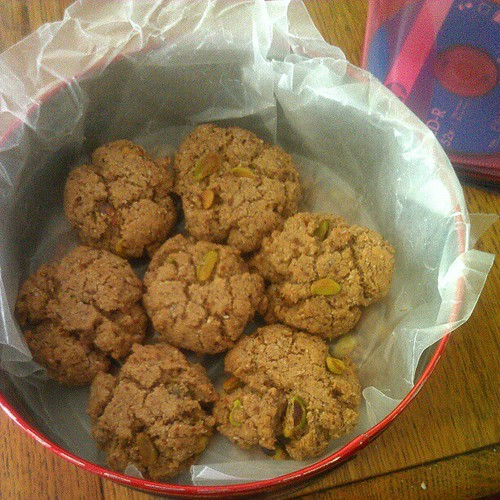 Unnecessary party prep: fantabulous flourless almond-pistachio cookies and 2nd birthday mix CDs. @zebrabelly