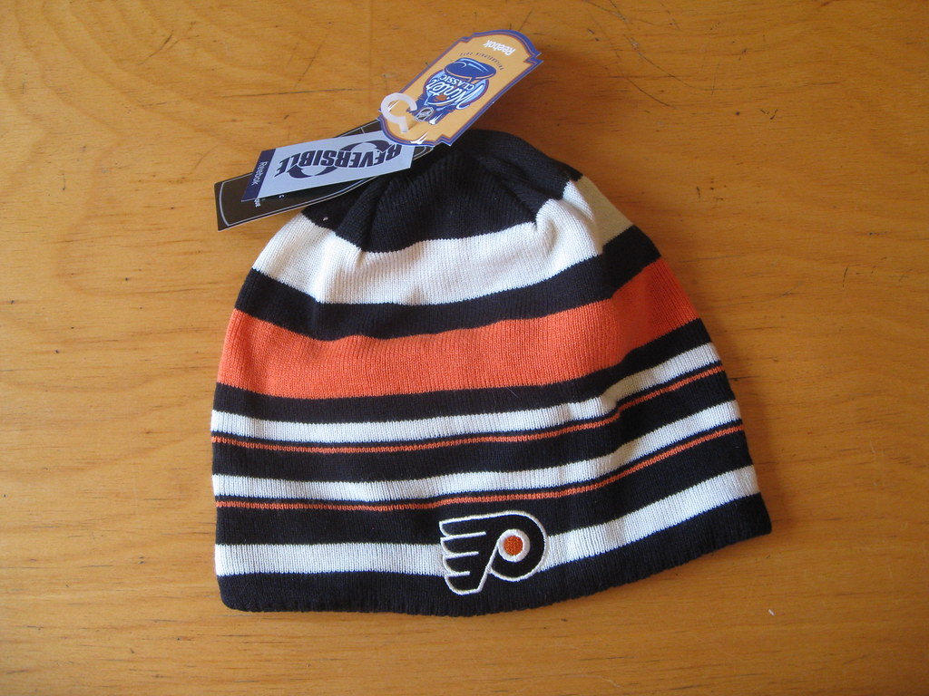 d5afa467fc5b43 A striped Flyers hat from last season's Winter Classic. Technically  reversible, but the other side is so boring that I didn't even bother to  photograph it.