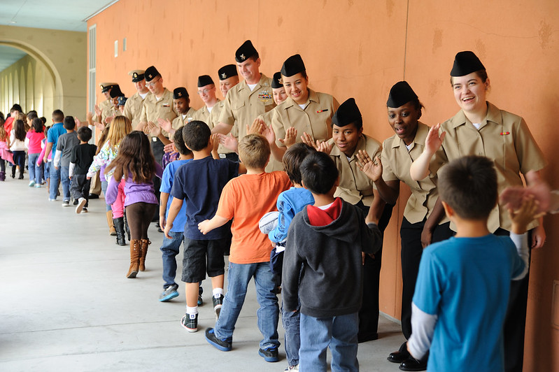 Sailors visit with students at Wolf Canyon Elementary School in Chula Vista