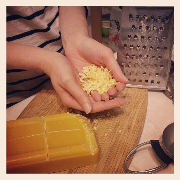 Grating beeswax for spoon oil.