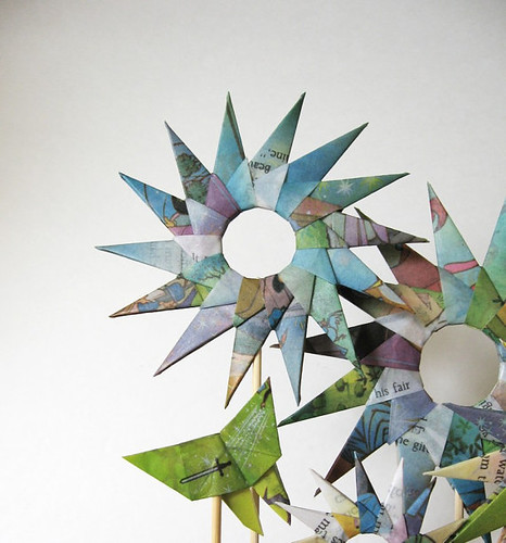 origami folded star garden made of colorful illustrated book pages