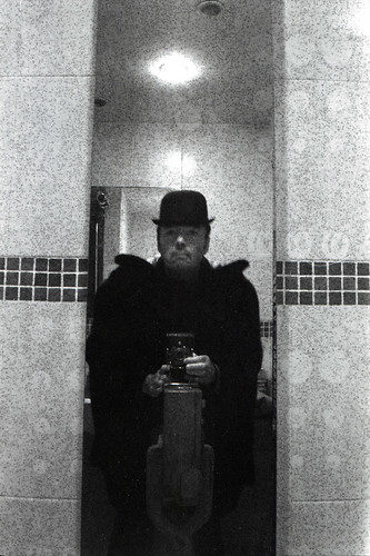 reflected self portrait with Kodak No.1 folding camera and bowler hat by pho-Tony