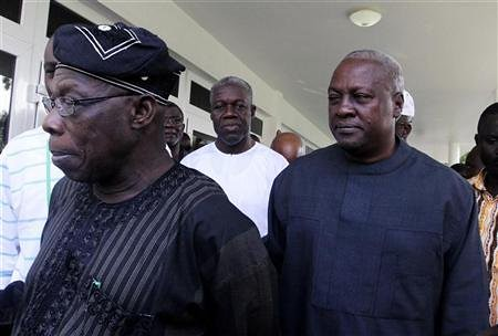 Newly-elected Ghana President John Mahama with elder Nigerian statesman Ret. Gen. Olusegun Obasanjo. Mahama was declared winner of the Ghana elections. by Pan-African News Wire File Photos