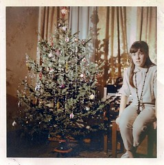 """Why, Yes, Mother, I'd Be Delighted To Have You Take My Picture By The Christmas Tree."""