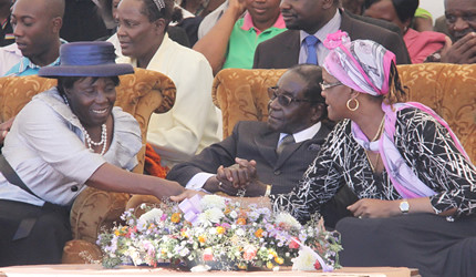 Republic of Zimbabwe President Robert Mugabe with First Lady Amai Grace at funeral of her aunt inside the country. Mugabe calls for the respect of the nation's sovereignty. by Pan-African News Wire File Photos