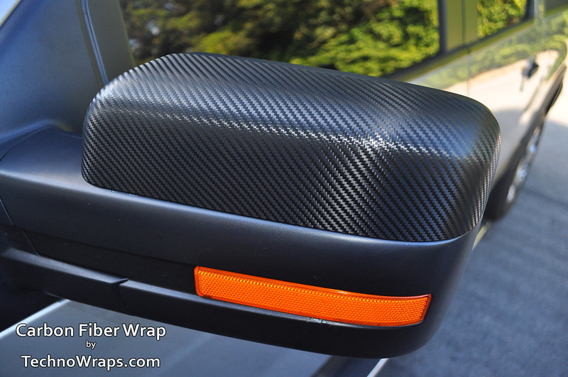 Carbon fiber wrapped mirror
