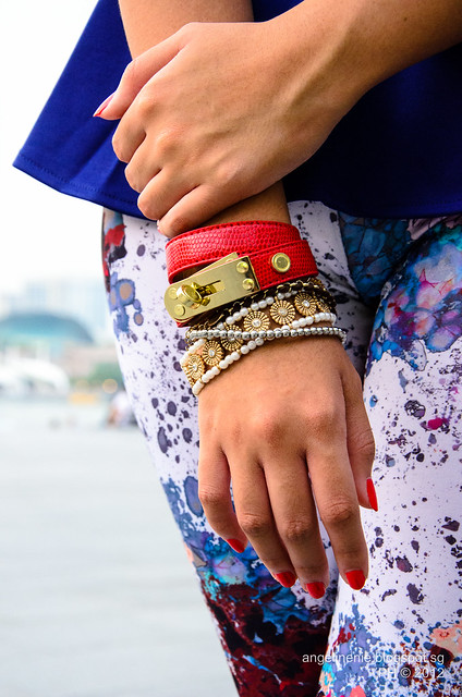 woman's hand with many bracelets and accessories that are loose