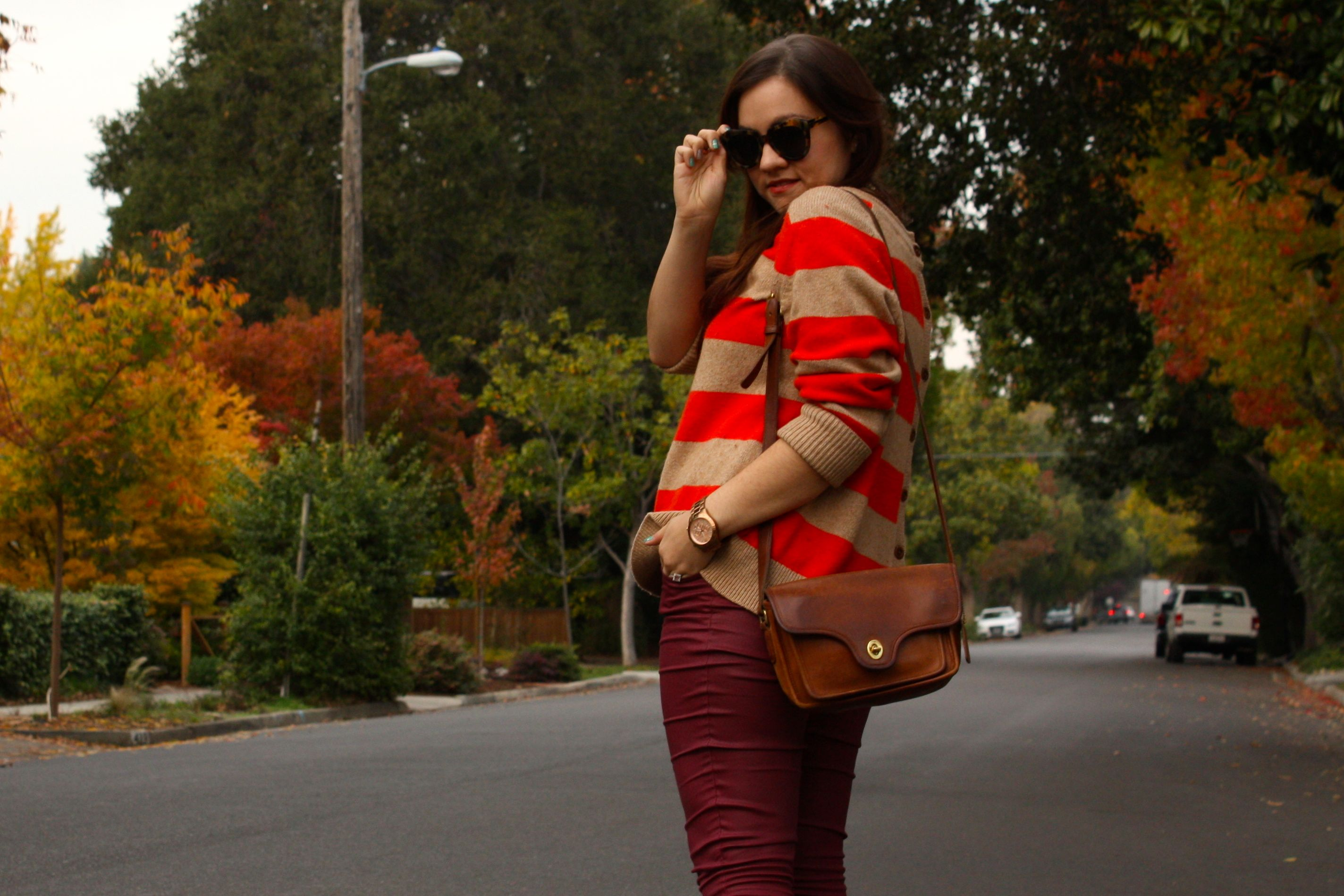 burgundy waxed jeans with orange striped lands end sweater and brown coach bag plus glitter booties02