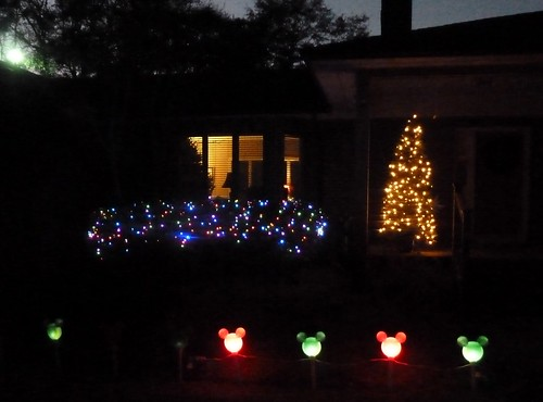 Front porch with flashing Mickey lights out front
