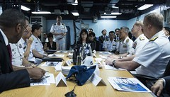 Japanese Minister of Defense Tomomi Inada receive a brief about the mission of forward-deployed naval forces aboard USS Ronald Reagan (CVN 76). (U.S. Navy/MC2 Adrienne Powers)