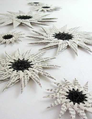 folded book page stars with black thread stitched centers