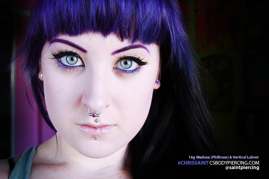 vertical labret medusa piercing by chris saint a photo on flickriver