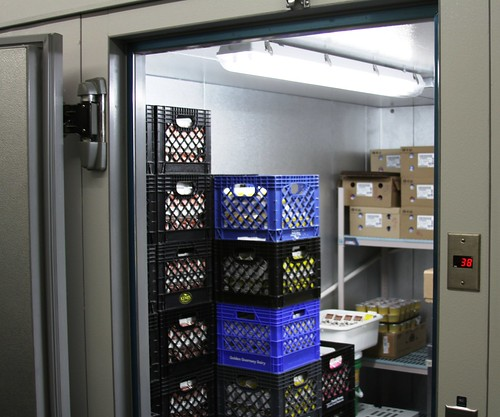 A new walk-in cooler, funded partially by USDA Rural Development, helps the Tracy School District serve more local foods at school lunches.