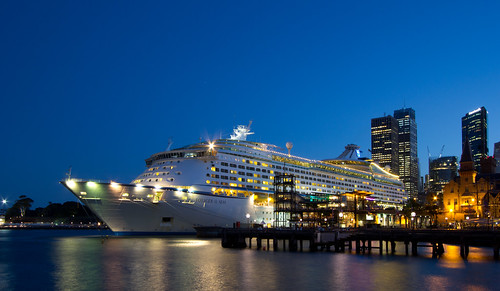 The Voyager of the Seas dwarfing the Overseas Passenger Terminal