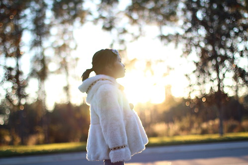 sunset white girl child bokeh coat litte
