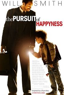 Pursuit of Happyness poster, which features Will Smith in a suit, holding his young son's hand. A light (the sun?) is shining from where their hands meet.