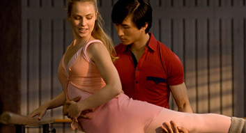 Chi Cao standing with Amanda Schull in Mao's Last Dancer