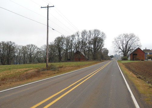 Two barns flank the road