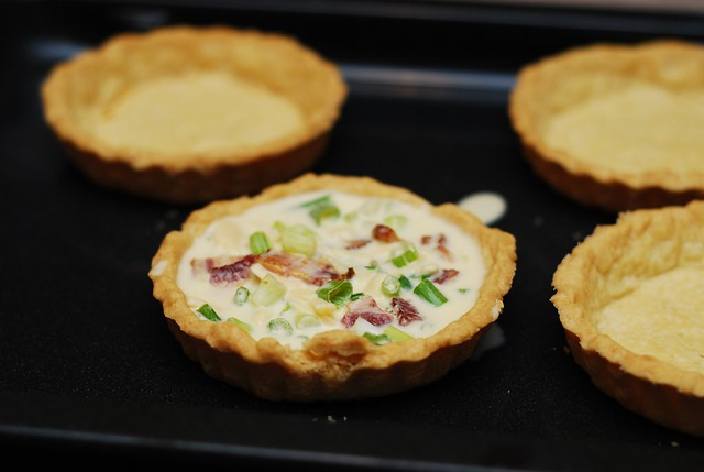 placing filling into tartlets