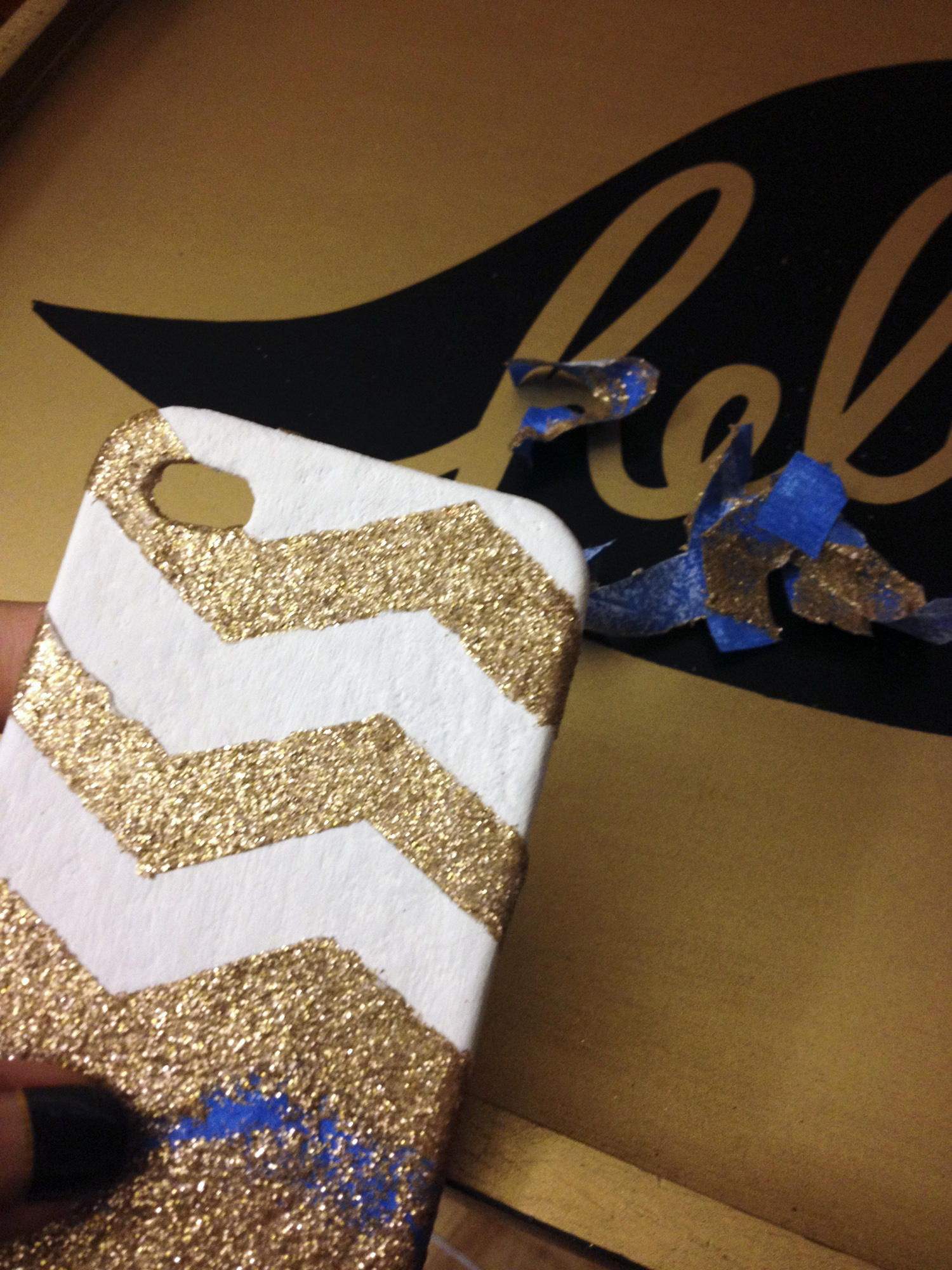 phone case makeover - peel off tape to reveal chevron pattern in glitter