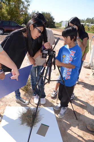 Pueblo of Acomo students take digital pictures of blackbrush canopy that will be used to determine exact crown coverage.