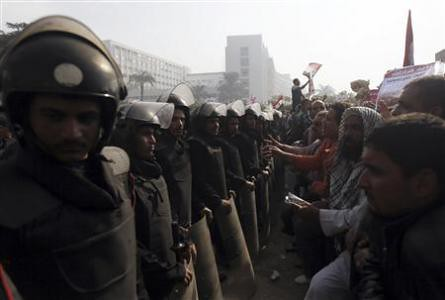 Supporters of the Muslim Brotherhood President Mohamed Morsi stand in front of riot police outside the judiciary. Both pro-government and anti-government demonstrations have been held over the last two weeks. by Pan-African News Wire File Photos