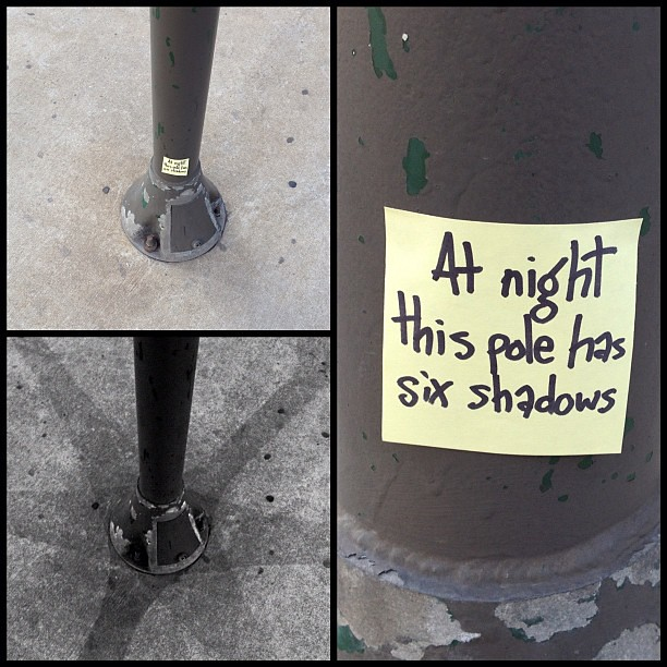 "The next morning I added this sticky note for the daytime dwellers to read, ""at night this pole has six shadows"""