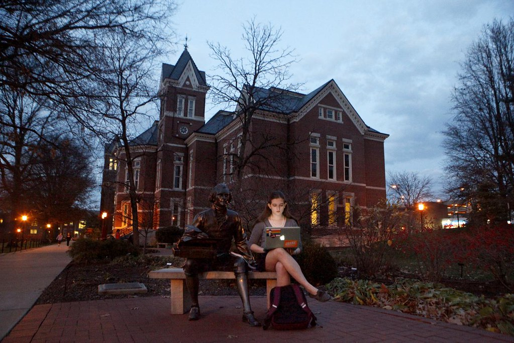 JAIME HENRY-WHITE/Missourian  MU journalism student Catherine Cojocaru sends emails while sitting next to the Thomas Jefferson statue Monday Dec. 3, 2012 on the David R. Francis Quadrangle.