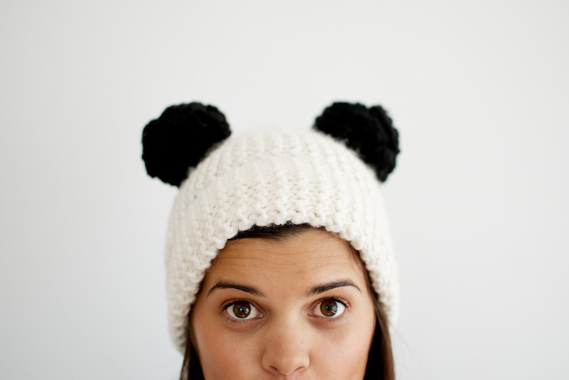 blogger Geneva Vanderzeil makes a DIY double pom pom beanie