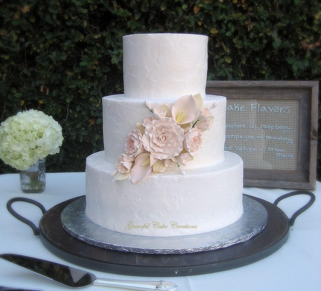 Elegant Textured Buttercream Wedding Cake with Ranunculas
