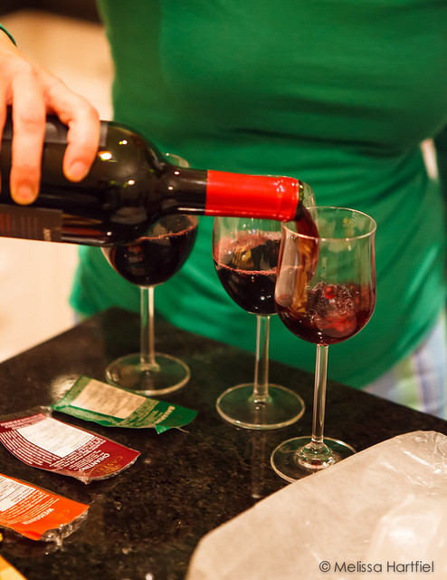 Pouring three glasses of red wine