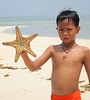 Filipino Boy Holding a StarFish