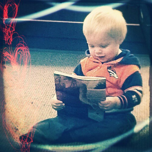 "He grabbed a magazine and ""read"" it!"