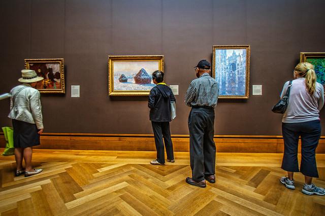 Admiring Impressionist Artwork