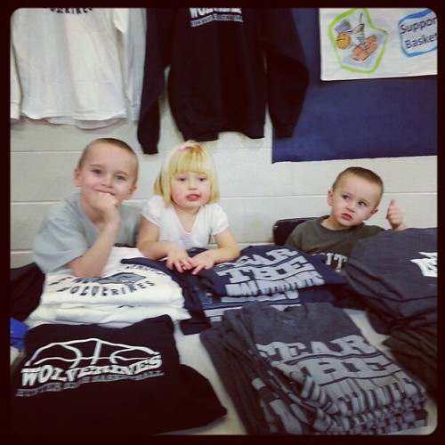 Selling t-shirts at last night's game.  Getting them working young.