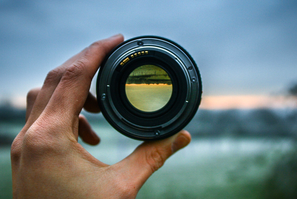 Through the lens.