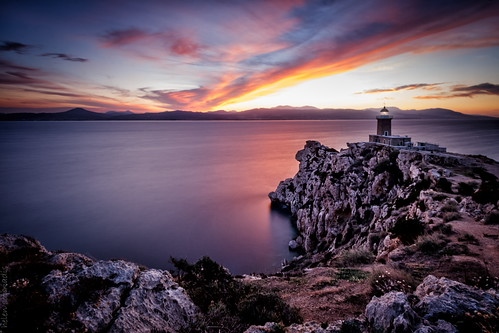 longexposure blue sunset red sea sky orange cliff lighthouse seascape water yellow clouds canon landscape rocks published purple greece loutraki canonefs1022mmf3545usm perahora canoneos40d melagavi