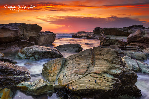 ocean red orange sun seascape color colour beach water swansea clouds sunrise newcastle print landscape photography photo intense rocks photographer image australia canvas nsw chalkys kiallfrost