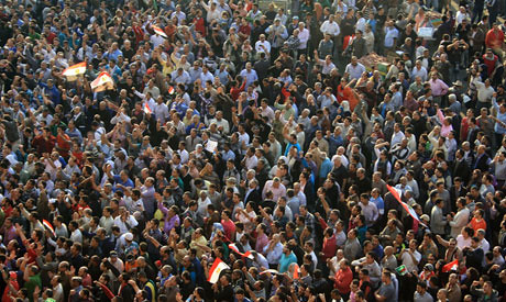Egyptians demonstrate in Cairo over the new powers assumed by President Morsi. Many are already refering to him as a dictator. by Pan-African News Wire File Photos