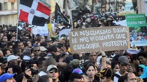"Nov. 11 protest in Santo Domingo, Dominican Republic. The sign reads ""Social inequality is more violent than any protest."" by Pan-African News Wire File Photos"