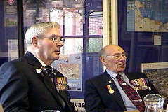 Lionel Emans (left) and Arthur Ayshford  of the British Infantry, discuss their days  in WWII
