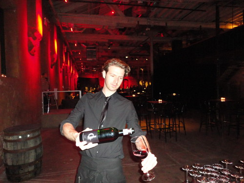 The back bartender pouring wine in the Fermenting Cellar