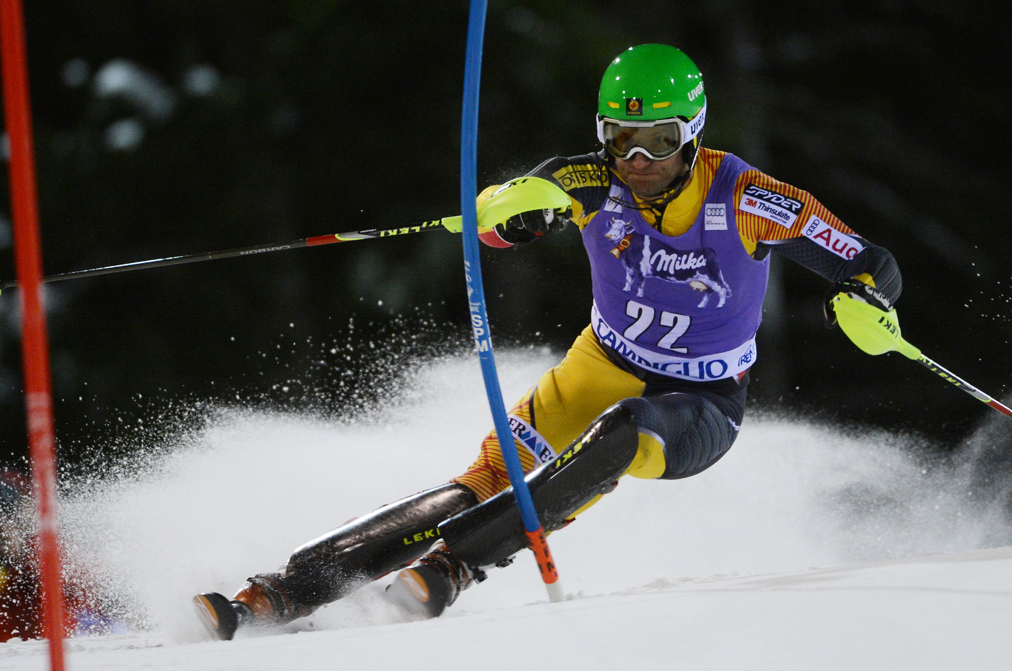 Mike Janyk charges hard during the night slalom in Madonna di Campiglio, Italy.